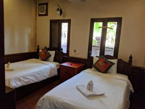 A bed or beds in a room at Villa Ban Phanluang
