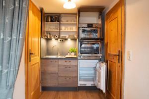 Küche/Küchenzeile in der Unterkunft Rostalm