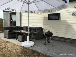 Ein Sitzbereich in der Unterkunft Chalet Duinzicht G68 Ameland