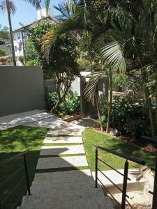 A garden outside Flats das Palmeiras
