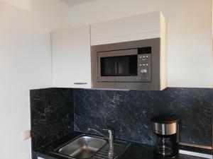 Küche/Küchenzeile in der Unterkunft Aparthotel Wattwurm