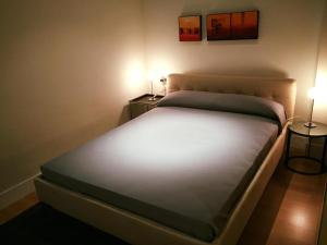 A bed or beds in a room at Apartamentos Arco
