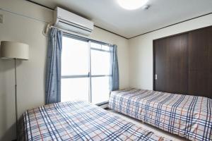 เตียงในห้องที่ NEW OPEN!JR今宮駅から徒歩1分 2LDK #602