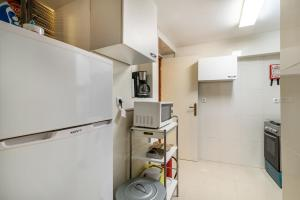 A kitchen or kitchenette at Lanui Belem Apartment