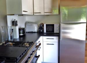 Küche/Küchenzeile in der Unterkunft Chalet L'Escalade