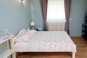Łóżko lub łóżka w pokoju w obiekcie Apartments Life & Energy