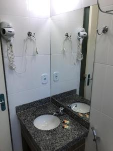 A bathroom at Apartamento Via Caldas L'Acqua II