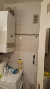 A bathroom at Blue House Apartment