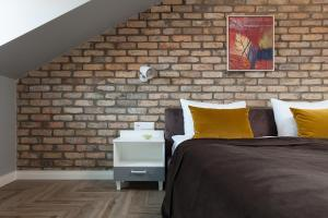 Кровать или кровати в номере Somnia Apartments