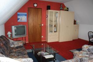 Un televizor și/sau centru de divertisment la Ferienwohnung Neumann