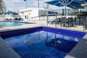 The swimming pool at or near Mandolin Resort