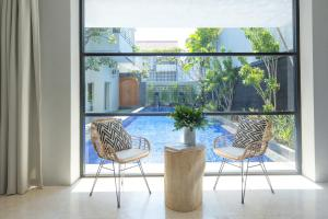 A view of the pool at Origin Seminyak or nearby