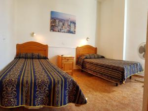 A bed or beds in a room at Very nice apartment near Yumbo, playa del ingles