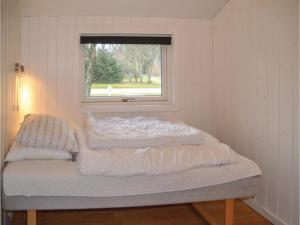 A bed or beds in a room at Holiday home Lyngshuse Herning XI