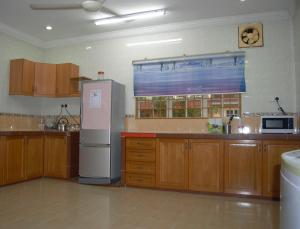 A kitchen or kitchenette at Gallery@7Homestay