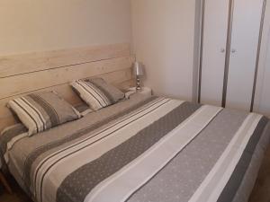 Un ou plusieurs lits dans un hébergement de l'établissement Appartandernos