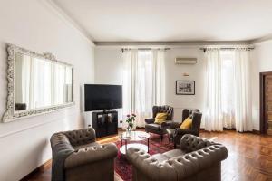 Coin salon dans l'établissement The Italian Suites