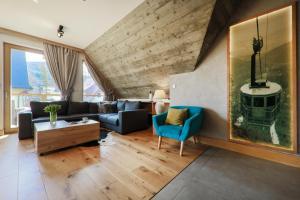 Posezení v ubytování OLI Apartments-Bertolli