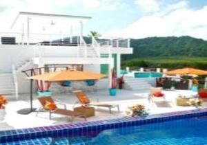 The swimming pool at or near Sunrise 3 bedrooms Apartment In Nai Harn