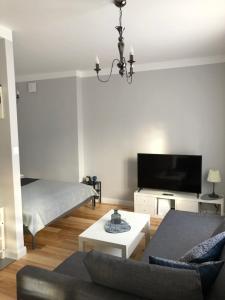 A seating area at Cichy Apartament w Centrum