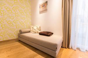Ein Bett oder Betten in einem Zimmer der Unterkunft Room 5 Apartments