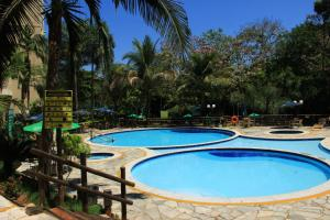 The swimming pool at or near Apto 124 p/ 4 Pessoas com Piscinas e Rio de águas quentes