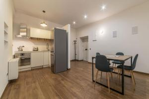 A kitchen or kitchenette at Sallustiano Terrace Apartment
