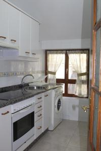 A kitchen or kitchenette at Apartamentos La Lula