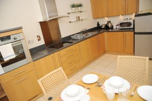 A kitchen or kitchenette at Century Wharf Serviced Apartments