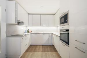 Кухня или мини-кухня в Exclusive Apartments in Luka