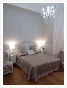 Postel nebo postele na pokoji v ubytování Casa De Rose