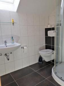 Ein Badezimmer in der Unterkunft Apartment Kraemer Dax
