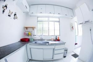 A kitchen or kitchenette at Apartamento Cidade Jardim