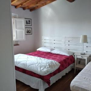 A bed or beds in a room at Mercatale