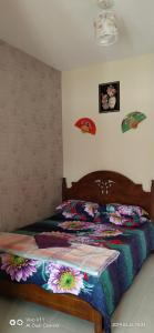 Katil atau katil-katil dalam bilik di SueHaz Homestay Arau