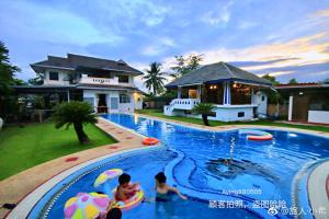 The swimming pool at or near Baan Suksomboon by Pei Jing