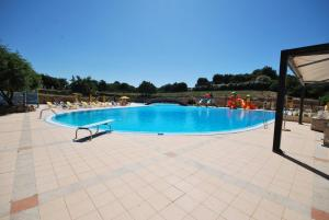 The swimming pool at or near Residence Rena Majore