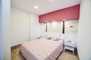 Cama o camas de una habitación en La Balconada de Toledo
