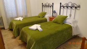 Alojamientos Guirado 객실 침대