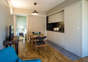 A television and/or entertainment center at Vibrant Porto Apartments