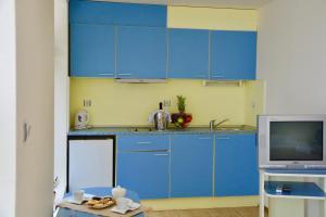 A kitchen or kitchenette at Rainbow Aparthotel