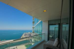 A balcony or terrace at Stunning 5* 4BR-Oceanfront-Apartment