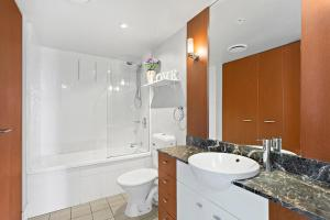 A bathroom at Beach Stay - Ocean & Riverview resort Chevron Renaissance central Surfers Paradise