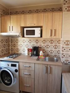 O bucătărie sau chicinetă la Casa Mirage 2