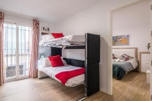 Een stapelbed of stapelbedden in een kamer bij Apartamento San Isidro