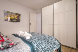 Een bed of bedden in een kamer bij Apartamento San Isidro
