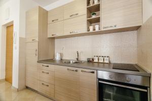 Кухня или кухненски бокс в Apartments Rivijera