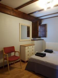A bed or beds in a room at Apartamentos LLave de Santillana