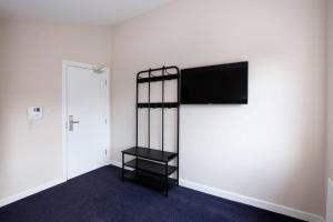 A television and/or entertainment centre at King Bedroom with Private Toilet near Denmark Hill