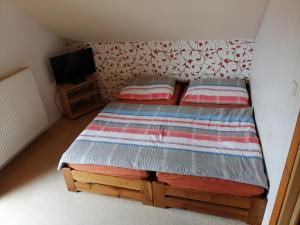 A bed or beds in a room at Apartment Veronika